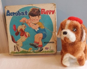 Vintage Wind Up Acrobat Toy Puppy Dog 1960s does flips, looks unused