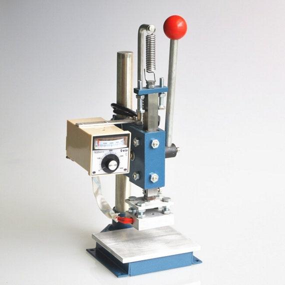 Custom written paper embossing machines
