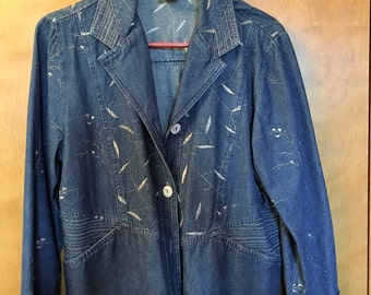 Denim Jacket with silver metallic accents.