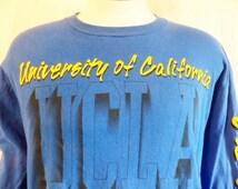 GO  UCLA Bruins vintage 90's University of California Los Angeles navy blue long sleeve graphic t-shirt yellow puffy sleeve print logo Large