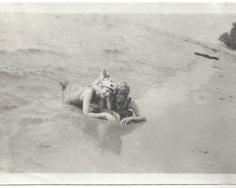 Old Photo 2 Women wearing Swimsuits and Caps at the Beach Lying in the Sand 1920s Photograph snapshot vintage