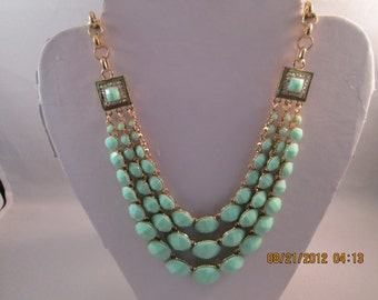 3 Row Bib Necklace with Turquoise Color Beads on a Gold Tone Chain