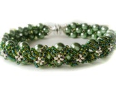Hand Woven 6mm Olive Green Glass Pearl Bracelet with matching Toho seed beads, metallic accent beads, silver magnet clasp