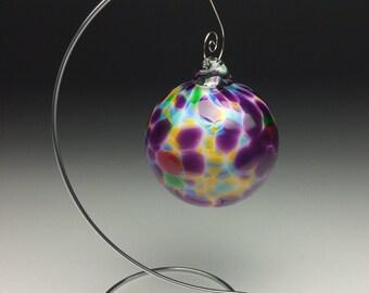 Multicolor hand blown glass ornament.