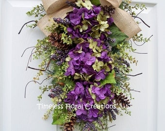 Purple and Green Hydrangea Swag with Pine Cones, Winter, Spring, Summer, Fall Door Decorating, Teardrop swag~Timeless Floral Creations