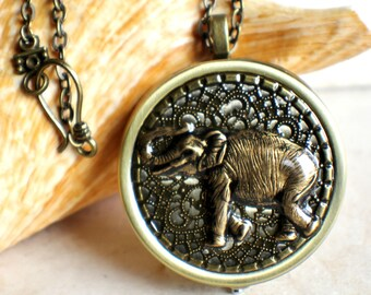 Music box locket, round  locket with music box inside, in bronze with bronze elephant on cover