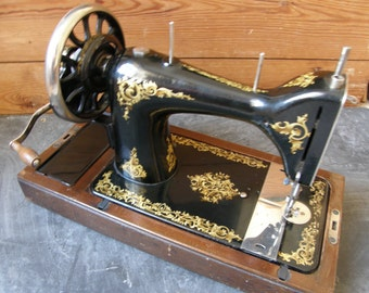 Fab the Morton, Manual sewing machine,in great condition with gold decals.Free UK postage