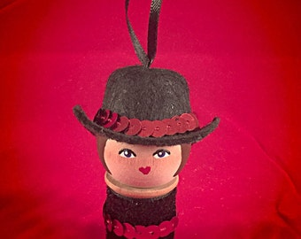 Cowgirl ornament: made from a vintage wood spool, handpainted, red sequence