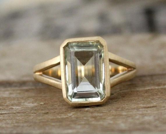 emerald cut green amethyst split shank bezel ring in by