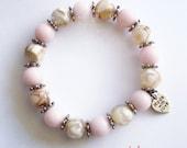 Pink and tan marbling beaded love bracelet