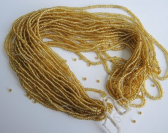 39+g hank of vintage bright yellow brassy gold seed beads- approx 11/0 width, small- ready to ship