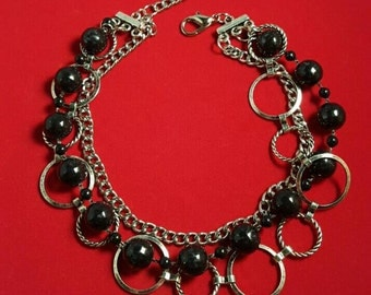 Multi strand statement  bracelet featuring a black bead strand