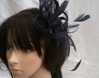 Navy Sinamay and  Feather Fascinator with double swirls and loops..on a comb