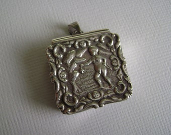 vintage repousse sterling box/locket
