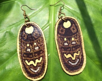 Earthy shield gold and silver leather earrings.