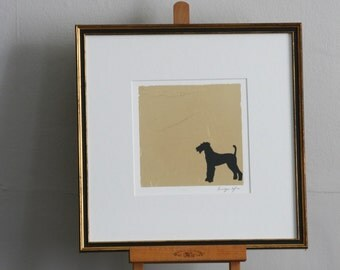 Hand drawn pen and ink silhouette of a dog on Gold leaf.
