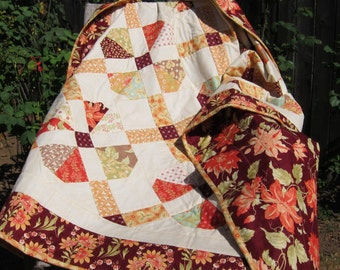 """Orange, Red, Maroon, Cream, Green, Brown and Teal Floral """"Clover"""" Lap Quilt"""