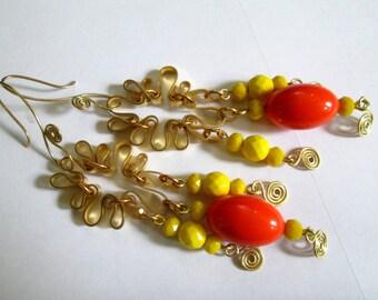 gypsy hippie long shoulder duster dangle earrings. orange. yellow. brass.