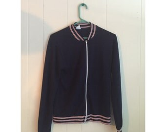vintage navy jacket with red and white striped details