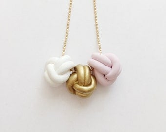 Gold Love Knot Trio Necklace - beautiful handmade polymer clay jewellery by Clay & Clasp