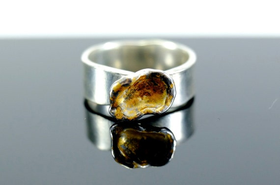 Water-cast silver and gold ring