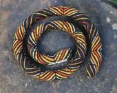 Black with Orange stripe blend SpiraLock. Designer quality cotton. Vegan. Original bendable dread tie