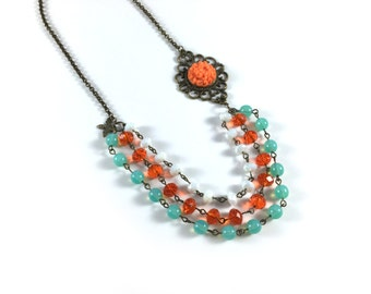 Orange Flower Necklace - Antiqued bronze/brass 3-strand necklace with orange resin flower cabochon and orange, aqua and white glass beads
