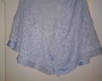 NEW ITEM! Hand knit, open work lacy pattern pale blue shawl. In half circle design. Some color change on hem.