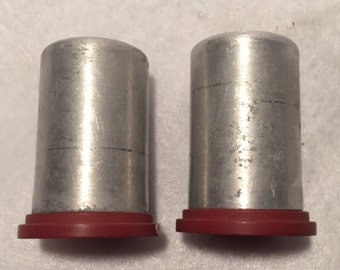 Tin salt and pepper shakers with burgundy colored plastic bottoms