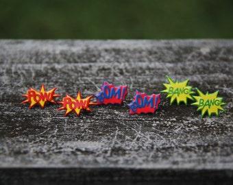 "Comic style stud earrings: ""Pow,"" ""Bang,"" or ""Boom."""