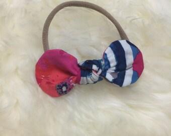 Poppy knotted bow on skinny nylon band headband