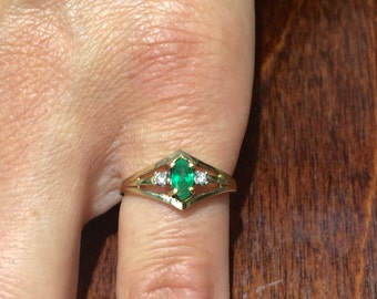 14k yellow gold marquise shaped emarald and diamond ring