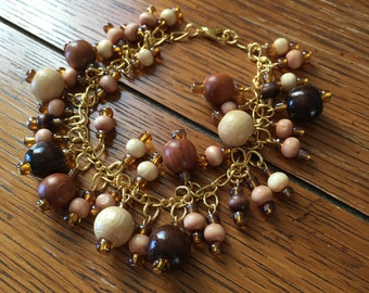 Bracelet. Brown Earth tone Wood bead charms on Gold Chain. Charm Bracelet. 7.5 inches.