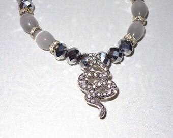 Silver snake charm necklace