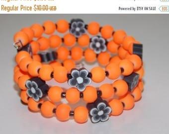 25%OFF Girls Neon Orange and Black Flower Bracelet