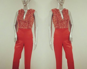 Red faux leather jumpsuit with sequin top