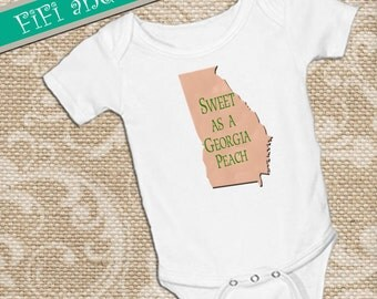 "Georgia baby ""Sweet a as Georgia Peach"" on baby onsie Snap bottom all in one bodysuit, white, peach, green lettering"