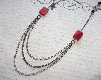 Red and black multi strand chain necklace