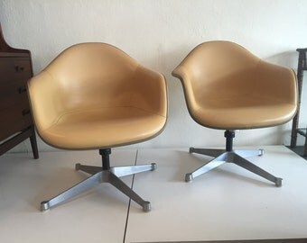 Pair of Eames Shell Tilt and Swivel Chairs