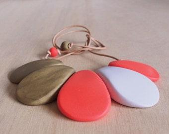 Stunning tangerine and bronze petals polymer clay bib necklace