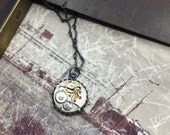 Silver steampunk necklace.  Oxidized Sterling Silver and watch movements. Handcrafted artistic jewelry -The Victorian Magpie