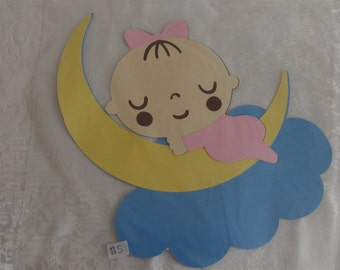 Baby sitting on the moon wall hanging