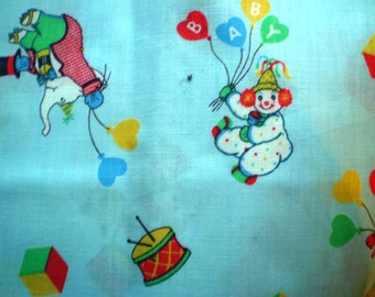 60 inches Circus Fun on light blue cotton. Clowns, elephant with balloons. Last piece