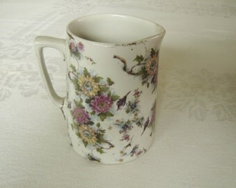 Soho Pottery multifloral creamer or small pitcher GUC (73F)