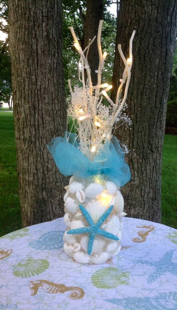 Turquoise beach wedding decor starfish shells lighting