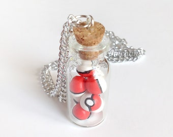 Pokeballs in a Bottle - Necklace / Keychain