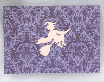 less than half price clearance sale white flying witch on purple floral halloween card