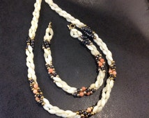 Mother of pearl beads with coral and heamatite , necklace and bracelet