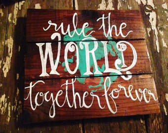 Rule the World Together hand painted reclaimed wood sign