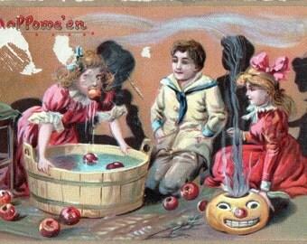 Vintage Tuck's HALLOWEEN POSTCARD: Children Bobbing for Apples
